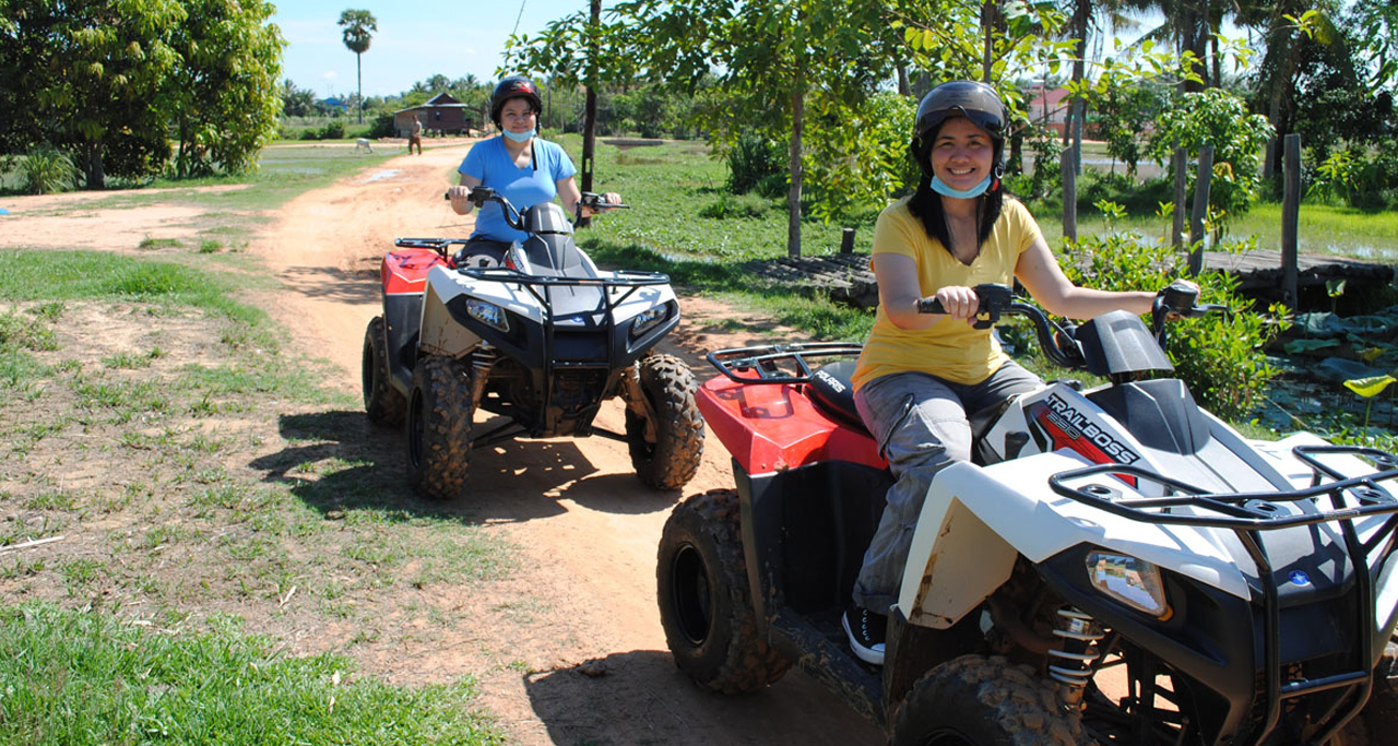 Adventurous tourists can try quad bike to explore off road tracks in Cambodian countryside.