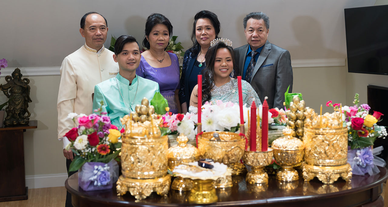Gold trays of fruits and gifts are arranged on the table.