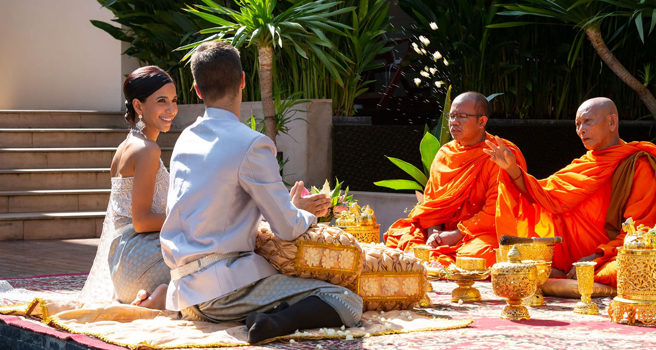 Monks give special blessings for newlywed couple.