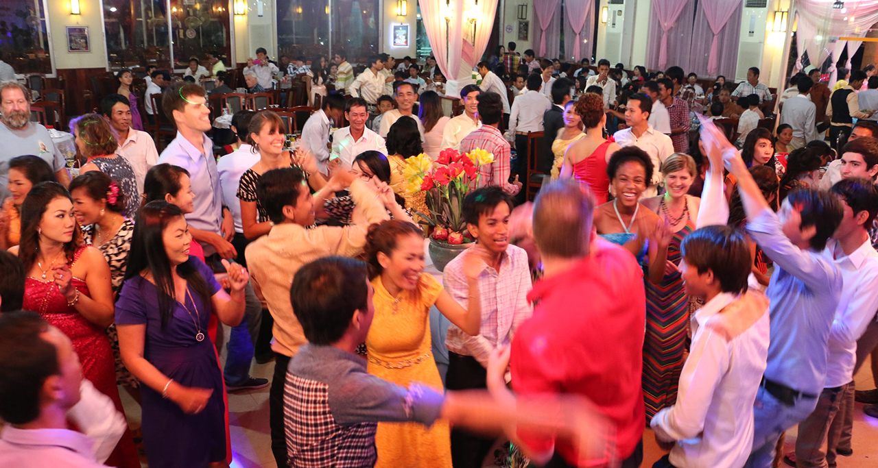 Wedding Ceremony in Cambodia: All guests celebrate the wedding ceremony with more songs and dances at late night.
