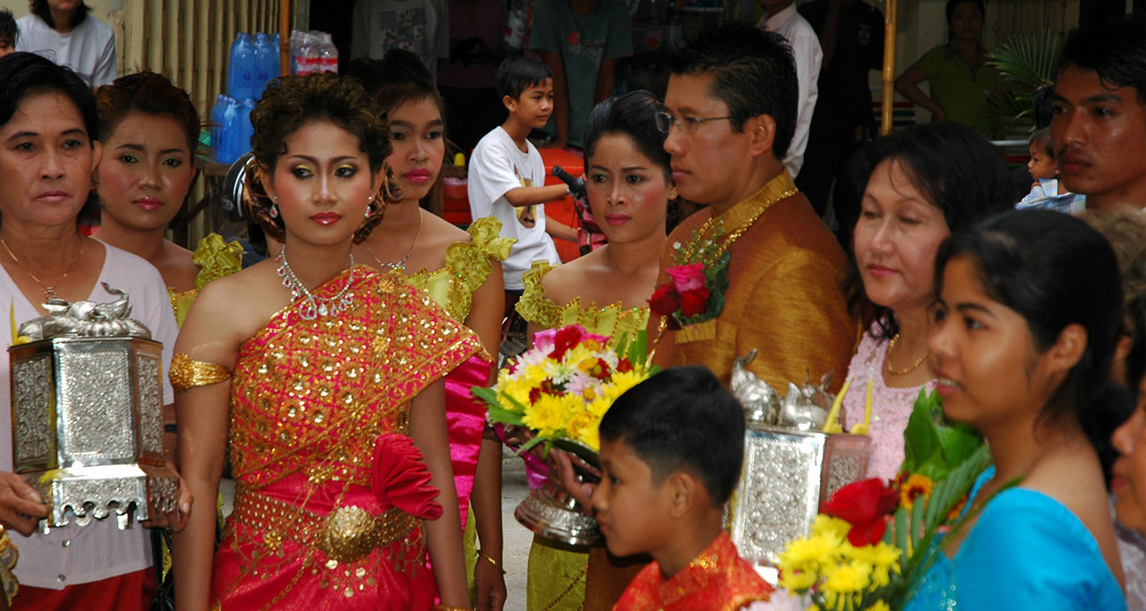 Cambodian weddings start when the groom and his family bring presents and travel to the bride's home.