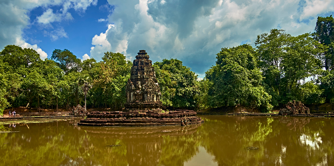 The central tower in Neak Pean can be accessible by the long boardwalk over the pond.