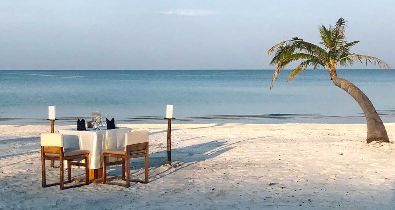 Romantic dinner set-up on Secret Garden Koh Rong's private beach.