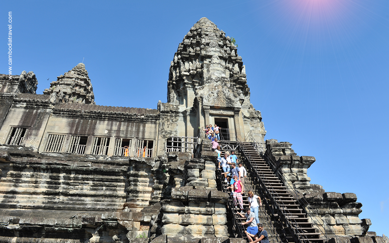 Tourists conquer steeped steps leading to Angkor Wat's high towers.